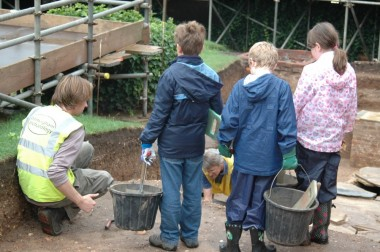 Young archaeologists in action at Dig Shakespeare