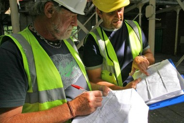 Consulting the plans: Image courtesy of Wessex Archaeology